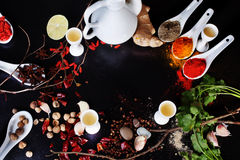 Space background spices chilli turmeric curry ingredients black top Royalty Free Stock Photos