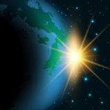 Space background. With sun rising behind a fictional Earth Royalty Free Stock Photos