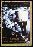 Space capsule, Space successes of the USA, large format serie, circa 1973. MOSCOW, RUSSIA - MAY 25, 2019: Postage stamp printed in Ajman shows Space capsule royalty free stock photos