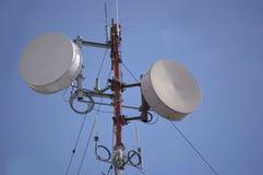 Space comunication. Comunication technology on a radio antenna tower Stock Photos