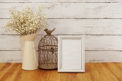 Space copy background with dried flowers bouquet home decoration. On wooden background royalty free stock photography