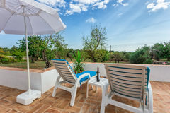 Space in the garden for relaxing with red wine. Royalty Free Stock Photos