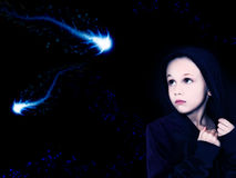 Space Girl. Beautiful girl looking at space creatures in the night sky stock photos