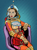 Space girl beauty sexy science fiction. Pop art retro style. A woman sits in a chair. International womens day. Female power Royalty Free Stock Image