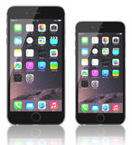 Space Gray iPhone 6 Plus and iPhone 6. Apple Space Gray iPhone 6 Plus and iPhone 6 showing the home screen with iOS 8.The new iPhone with higher-resolution 4.7 Stock Photography