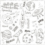 Space hand drawn doodles. Stars, planet and space transportation Stock Photography