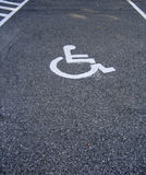 Space for handicap's car in the parking lot. Designated space in parking lot for handicap's car royalty free stock images