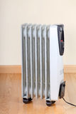 Space Heater. Electric radiator room space heater on a wood floor Royalty Free Stock Images