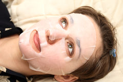 Space hygiene. The girl lays  with a facial mask Royalty Free Stock Photos