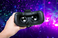 Space image in virtual reality glasses. Hands holding switched-o Stock Photo