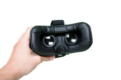 Space image in virtual reality glasses. Hands holding switched-o Royalty Free Stock Photo