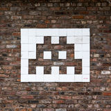Space invader graffiti. A graffiti of a space invader from the famous video game Stock Images