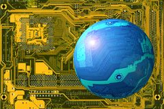 Space landscape. Flying object (blue circuit board as a sphere) on yellow background (another circuit board Royalty Free Stock Photography