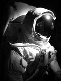 Space man. A complete astronaut setup under dramatic lighting.  Black and white Royalty Free Stock Photo