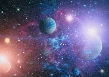 Planets, stars and galaxies in outer space showing the beauty of space exploration. Elements furnished by NASA. Space many light years far from the Earth Royalty Free Stock Images