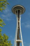 Space Needle with a lift framed by tree in Seattle Stock Photo