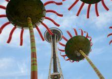 Space needle viewed through Sonic Bloom sculpture in Seattle Center. stock image