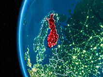 Finland on Earth at night. Space orbit view of Finland highlighted in red on planet Earth at night with visible country borders and city lights. 3D illustration Royalty Free Stock Photos