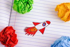 Space Rocket Blasting Off For New Ideas Through Colourful Crumpled Paper Balls. Close up stock photos