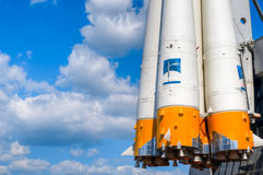 Space rocket engine. Details of space rocket engine against blue sky with clouds Stock Photo