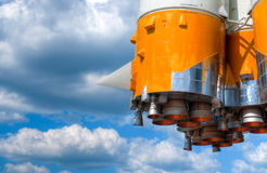 Space rocket engine. Details of space rocket engine against blue sky with clouds Royalty Free Stock Images