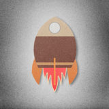 Space rocket flying in space cut paper craft on paper background Royalty Free Stock Photos
