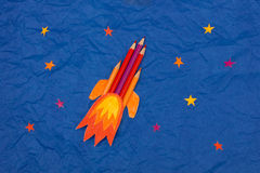 Space rocket illustration with colored pencils in space with stars background. Useful image for science, school, imagination topics or events Stock Photos