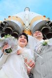 Space rocket over fiance and bride Royalty Free Stock Photos