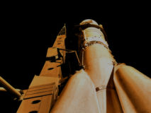 Space rocket at the start of the image in retro style Royalty Free Stock Image