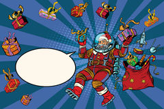 Space Santa Claus in zero gravity with Christmas gifts Royalty Free Stock Photography