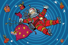 Space Santa Claus in zero gravity with Christmas gifts. Pop art retro vector illustration. Blue cartoon circles background radiation Royalty Free Stock Photo