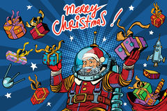 Space Santa Claus in zero gravity with Christmas gifts Royalty Free Stock Images