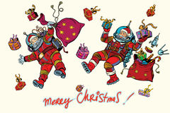 Space Santa Claus in zero gravity with Christmas gifts Stock Photos