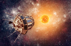 Space satellite on a background star sun Royalty Free Stock Image