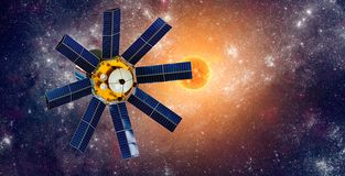 Space satellite orbiting the earth on a background star sun stock images