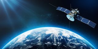 Space satellite orbiting the Earth. 3d rendering. Space satellite orbiting the Earth. 3d royalty free illustration