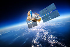 Space satellite over the planet earth. Space satellite orbiting the earth Stock Photo