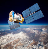 Space satellite over the planet earth. Space satellite orbiting the earth Royalty Free Stock Image