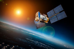 Space satellite over the planet earth royalty free stock photography