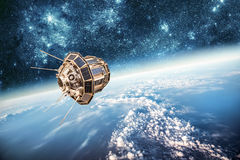 Space satellite over the planet earth stock image