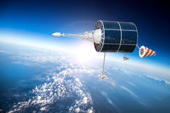 Space satellite over the planet earth Royalty Free Stock Image