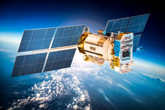 Space satellite over the planet earth. Space satellite orbiting the earth. Elements of this image furnished by NASA Stock Photography