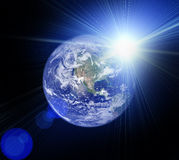 Space scene with planet and sun Royalty Free Stock Images