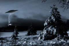Space-ship landing in cold winter landscape Stock Photos