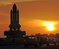 Space shuttle. The space shuttle Discovery is being rolled out to launch pad 39A this morning.    Photo by: Michael R. Brown Royalty Free Stock Photography