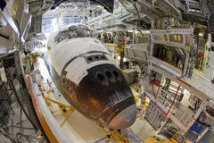 Space shuttle. The space shuttle Endeavour is being moved out of the orbiter processing building for the last time after it is prepared and fitted for display at Royalty Free Stock Photos