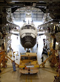 Space shuttle. The space shuttle Endeavour is being moved out of the orbiter processing building for the last time after it is prepared and fitted for display at Royalty Free Stock Image