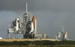 Space shuttle. Endeavour sits on pad 39-B (right) and the  Atlantis sits on pad 39-A (left) at Kennedy Space Center.   Photo by: Michael R. Brown Royalty Free Stock Photo