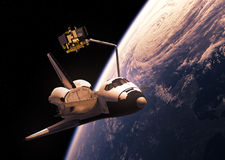 Space Shuttle Deploying Satellite Stock Photography