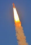 Space Shuttle Discovery Streaking Across the Sky. The might shuttle streaks across a blue Florida sky just seconds after take off leaving an amazing plume of Royalty Free Stock Photos